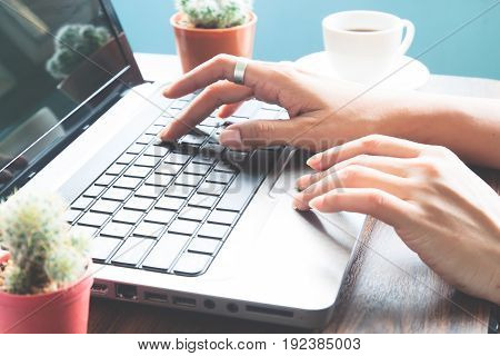 Woman hands using laptop computer Workspace Working at home