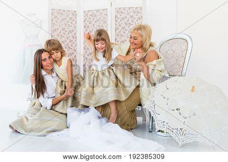 Portrait of happy grandma, mother and daughter in studio