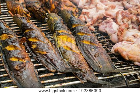 Street Food In Thailand. Sales Of Catfish And Pork Roast Or Barbecue Is Popular With Tourists And Th