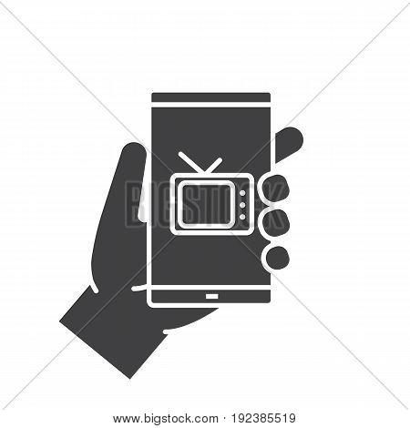 Hand holding smartphone glyph icon. Silhouette symbol. Smart phone television app. Negative space. Vector isolated illustration