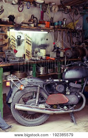 Motorcycle equipment and tools on the desktop in the garage