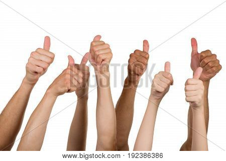 Human hands showing thumps up many people color group