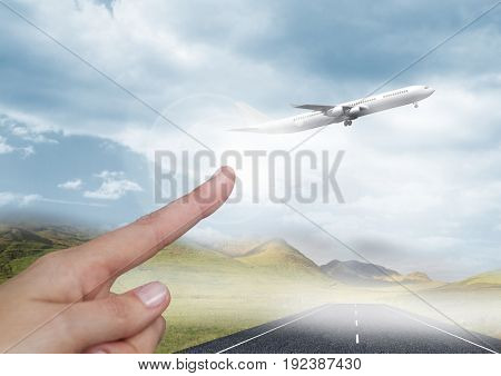 Digital composite of Hand pointing in  air of sky with airplane