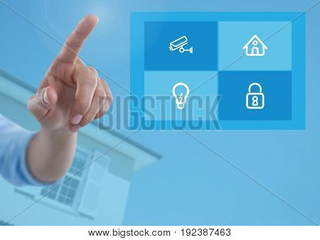 Digital composite of Hand touching a Home automation system App Interface