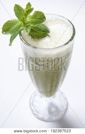 Green Smoothie With Mint And Celery On A White Background