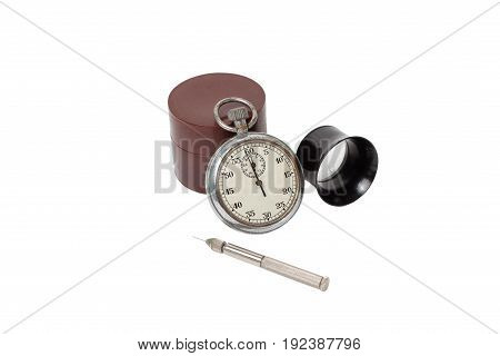 Antique mechanical stopwatch and clockmaker toolset on white background, isolated