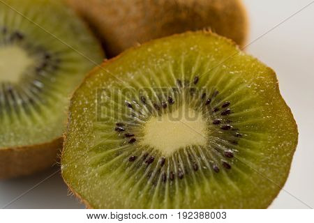 Part of  fresh organic kiwi on plate