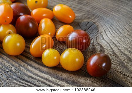 Cherry tomatoes on old rustic wooden background