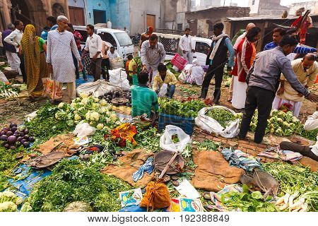 Vegetables sellers on the street market in Vrndavana. Natural products. India Vrndavana November 2016