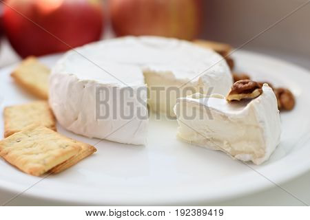 Cheese with white mold. Camembert or brie type. Radish and grape. Healthy breakfast.