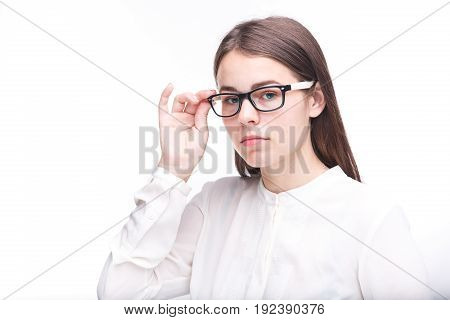 Beautiful Young Girl In Glasses With A Black Rim A White Shirt On An Isolated Background. Business C
