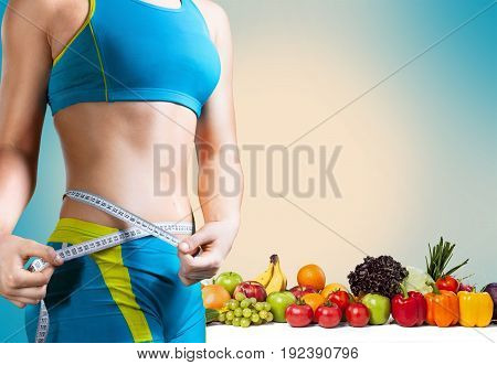 Young woman measuring waist thin sport beautiful