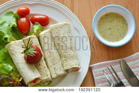 bread roll and salad dipping sauce on table
