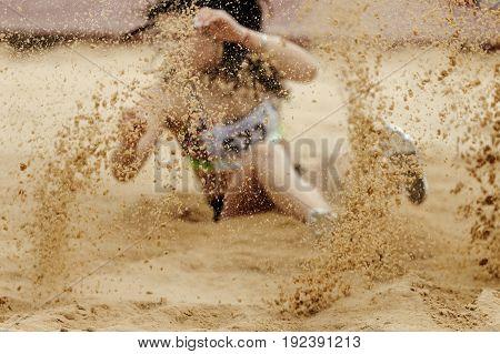 spray sand landing female athlete competition long jump