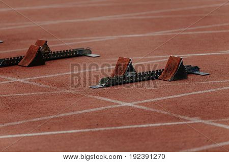 starting blocks on start line of sprint 100 meters