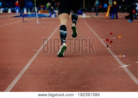 back running on track jumper athlete to compete in long jump
