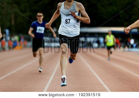 finish line winner man runner race 400 meters in competition