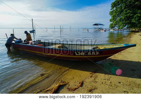Labuan,Malaysia-June 10,2017:Morning scene of daily activities at Tanjung Aru village,fisherman with fishing boat ready to fishing in Labuan island,Malaysia.