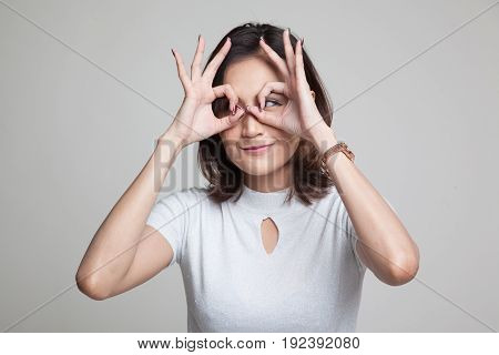 Asian Woman Do Funny  Double Ok Sign As Glasses.
