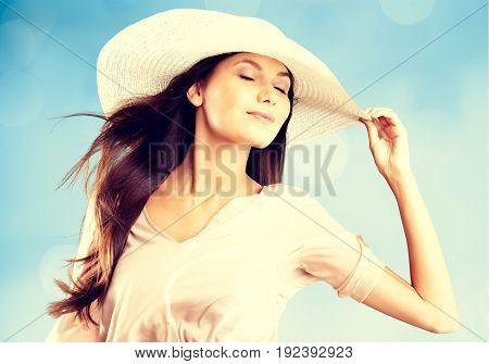 Young blond hat woman beach white beautiful