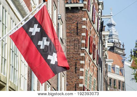 Flag of Amsterdam in the center of the city in the day