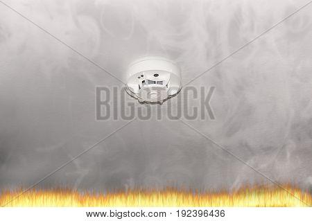 Smoke detector on the ceiling with red warning light sensor and smoke.