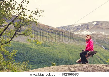 Tourist With Camera Looking At Scenic View In Mountains Norway