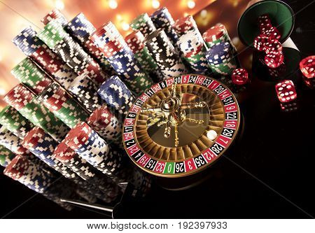 Casino blurred background. Roulette and stacks of chips.