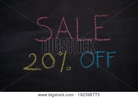 Sale 20% off. Sale and discount price sign drawn with chalk on blackboard