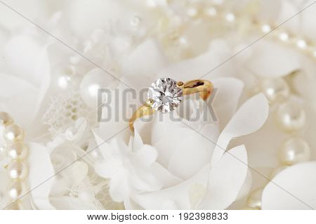 beautiful engagement ring and flowers