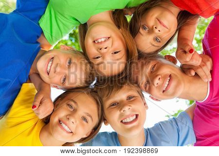 Group children looking at camera colorful view circle holding