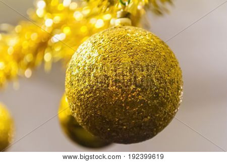 Shiny golden ball for Christmas tree decoration hanging