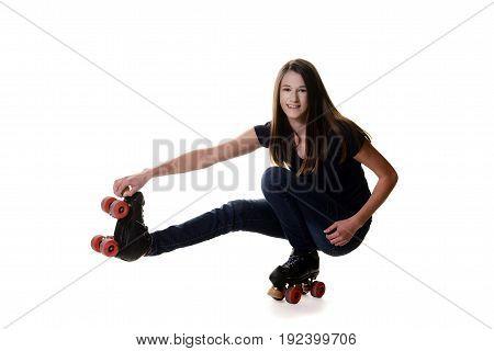 teen girl doing shoot the duck roller skate move