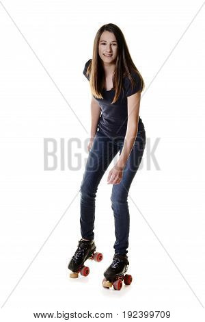 teen girl on quad roller skates with white background