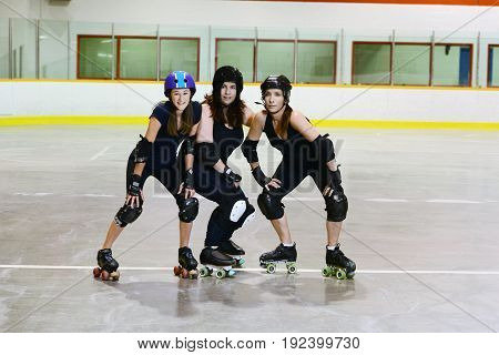 women roller derby players in an arena