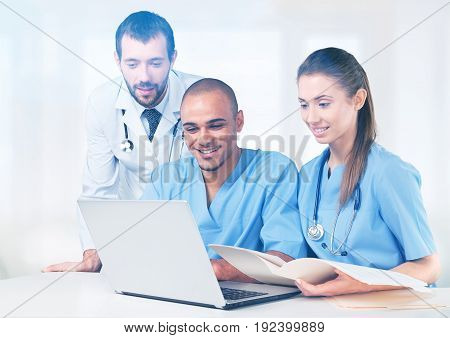 Medical laptop using successful doctors table group