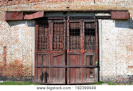 Large metal doors of the warehouse. What's been locked up for a very long time.
