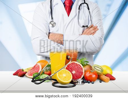Doctor standing doc arms crossed healthy food green white