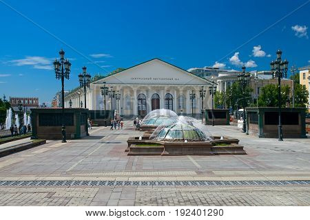 Moscow Russia - June 18 2017: People walk on Manezhnaya Square near Central Exhibition Hall Manege Moscow Russia.