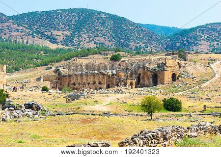 Ruins and old buildings in Hierapolis ancient city adjacent to modern Pamukkale in Turkey.