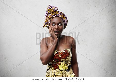 Omg! Surprised Or Terrified African Woman Holding Hand On Cheek Looking Shocked, Keeping Eyes Popped