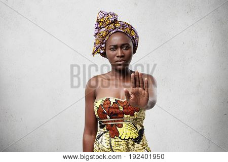 Stop It! African Woman With Dark Smooth Skin Wearing Traditional Clothes Showing Her Palm Denying No