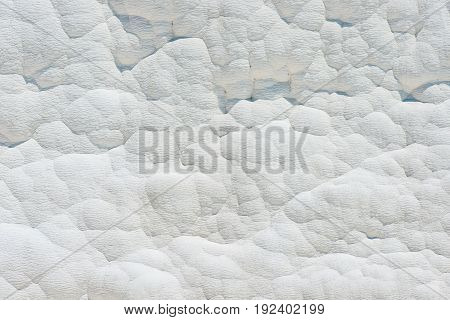 Travertine wall, white background in Pamukkale, Turkey