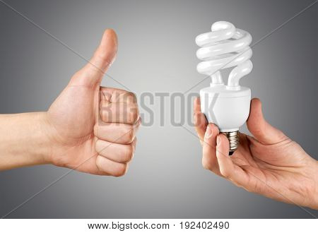 Holding hands lamp bulb young adult thumbs up color