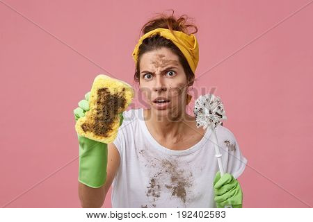 Annoyed Woman With Dirty Face Holding Sponge And Brush In Hands Having Bad Mood After Hard Work Abou