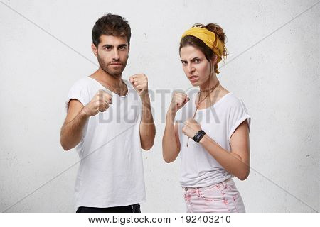 Angry Agrressive Young Caucasian Couple Standing In Defensive Position, Keeping Fists Clenched, Havi