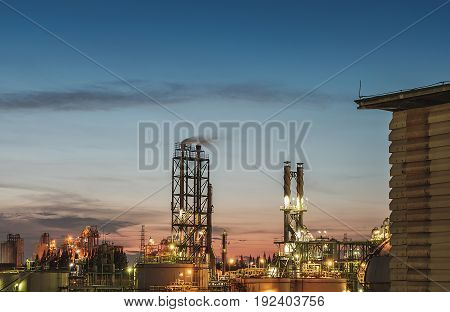 Petrochemical plant on blue sky with twilight time