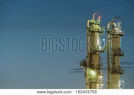 Distillation tower on blue sky with twilight time