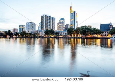 Beautiful cityscape view on the illuminated skyscrapers during the twilight in Frankfurt, Germany