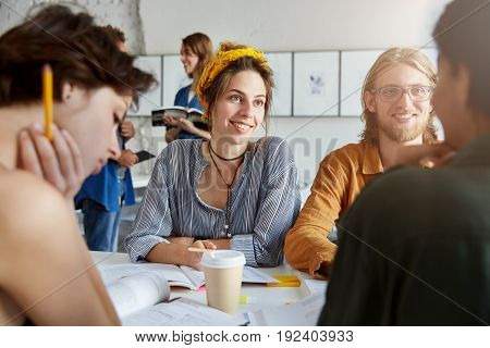 Group Of Best Friends Or University Students Hanging Out At Coffee Shop, Talking, Having Fun, Spendi
